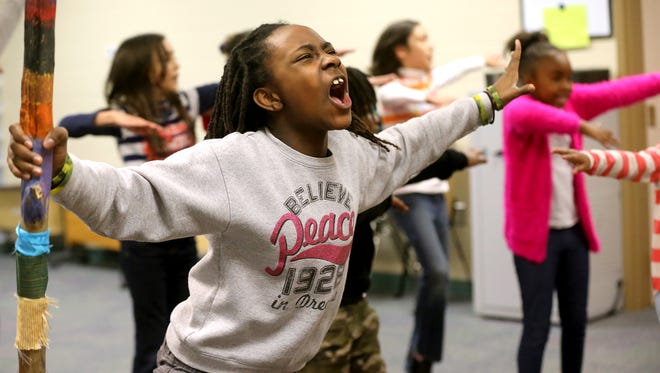 "Maria Warrick as Rafiki sings a solo during a rehearsal of ""The Lion King"" on Thursday, Jan. 21, 2016, at Bradley Academy."