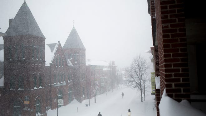 Snow falls at Central Market in York, Saturday. The market was closed for the day due to the storm.