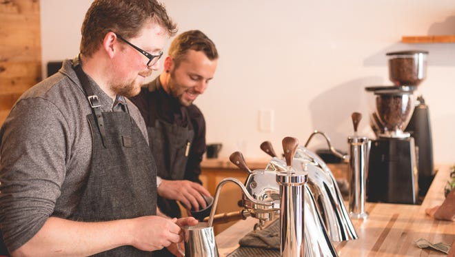 Chris Garrison, left, owner of Old World Coffee on California Avenue, is competing in the Brewers Cup portion of the U.S. Coffee Championships Feb. 2-5 in Kansas City. He is shown with Old World manager Kevin Stamps.
