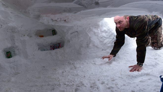 Skyler Cosey enters a snow cave he built in his yard Thursday, Jan. 28, 2016 in the 1400 block of Lincoln Way East, Chambersburg. The cave is complete with a skylight, TV and fireplace.