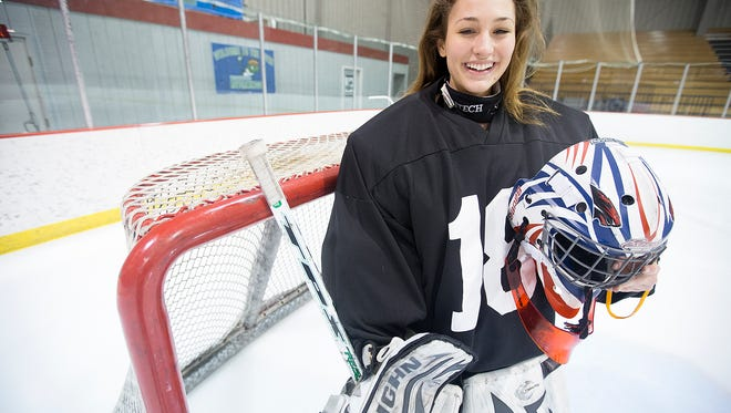 Wisconsin Rapids junior Chloe Krueser is a figure skater turned goalie for the Point/Rapids/Marshfield Red Panthers at the South Wood County Recreation Center in Wisconsin Rapids, Friday, Jan. 29, 2016.