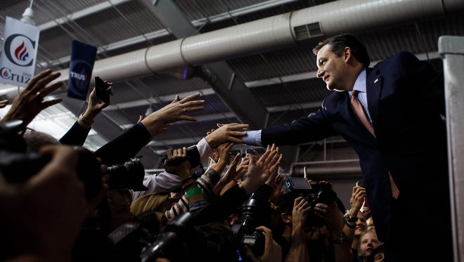 Republican presidential candidate Ted Cruz greets supporters on stage during his caucus night watch party inside the Elwell Family Food Center at the Fairgrounds on Monday, Feb. 01, 2016, in Des Moines.