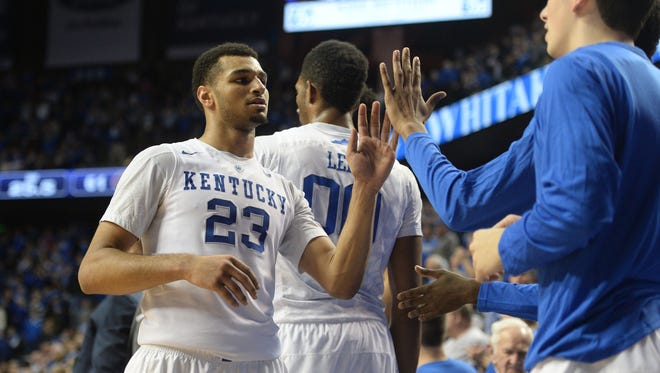 UK's Jamal Murray is congratulated after coming out of the game during the University of Kentucky basketball game against Florida at Rupp Arena in Lexington, Ky., on Saturday, February 6, 2016. Photo by Mike Weaver