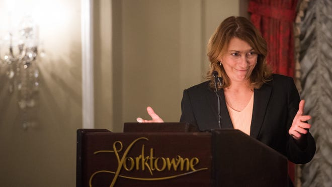 Sonia Huntzinger, who plans to step down from her role as executive director of Downtown Inc, gives a welcoming address during the Downtown First Awards in 2014.