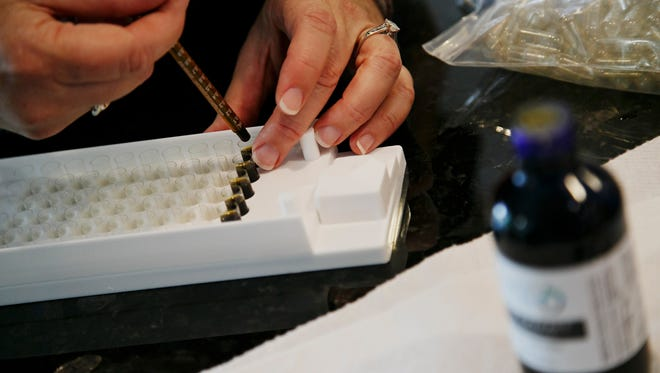 Charlotte's Web, a cannabis oil, is made into pills for a patient with severe epilepsy.
