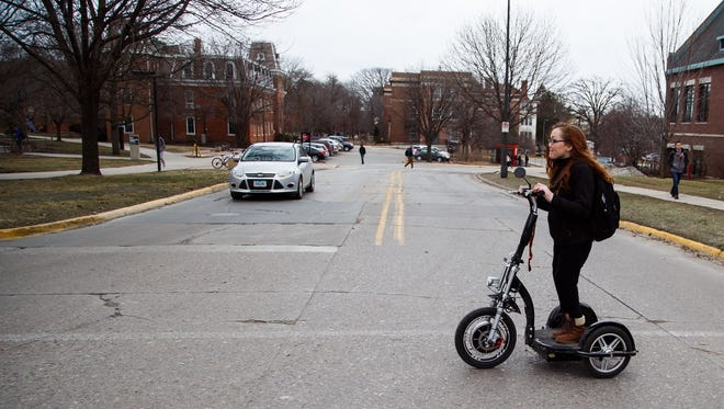 "ISU freshman Brittni Wendling rides her Triad to class on Wednesday, Feb. 24, 2016. ""I had someone ask me if I use it because I think it is a step up from a hoverboard,"" she said. Wendling is diagnosed with Larsen Syndrome which affects the development of bones throughout the body."