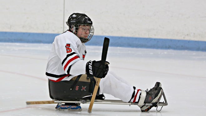 Sled hockey has provided a unique freedom for Hellam Township's John Tebay, 19. He was unable to participate in team sports after suffering a traumatic brain injury seven years ago.
