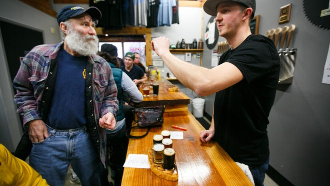 Chris Perry orders a tasting flight from Jake Bonham at Salem Ale Works. The brewery has just released two new coffee stouts.