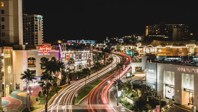 A time lapse photo of Tumon in front of The Plaza.