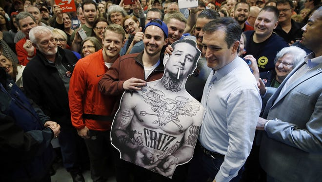 Republican presidential candidate, Sen. Ted Cruz, R-Texas, poses for photographs during a campaign stop on Sunday, March 13, 2016, in Columbus, Ohio.