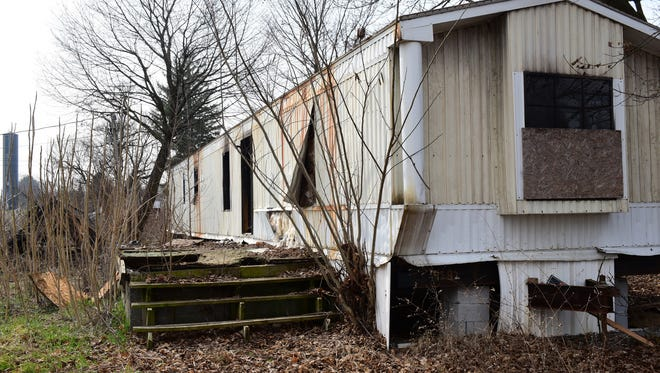 Fire damage is seen at a mobile home Wednesday, March 16, 2016 at 10317 Rowe Run Road, Orrstown. A man was charged with intentionally starting a fire at the home.