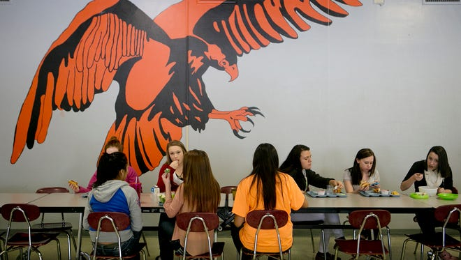 Student eat lunch in the cafeteria at John Edwards High School in Port Edwards, Friday, Jan. 23, 2015.