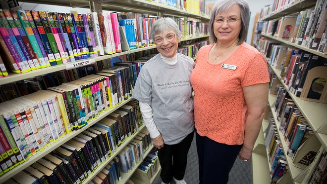 President of Lester Public Library Board of Trustees Jeanne Osgood, left, and director of the Lester Public Library Lore Ponshock, right, at the Lester Public Library of Rome, Tuesday, March 22, 2016.