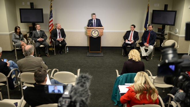 United States Attorney for the Eastern District of Kentucky, Kerry B. Harvey, addresses the media in Lexington, Ky., on Friday, March 25, 2016. Photo by Mike Weaver