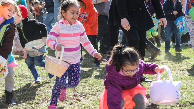 Children snatch up eggs at the 2016 Children's Charity of Greater Binghamton Easter Egg Hunt at Recreation Park. The event will be held again April 15.