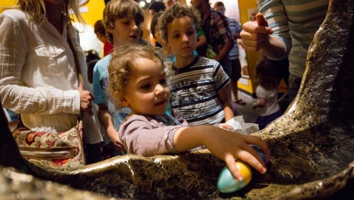 Mila Houssameddine (center) puts one egg back after