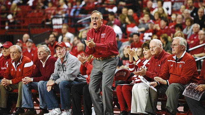 USD president James Abbott cheers on his team during a WNIT semifinal game against Oregon Wednesday, March 30, 2016, at the DakotaDome in Vermillion, S.D.