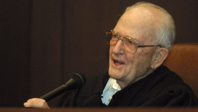 An emotional Nevada Supreme Court Justice Cliff Young, 80, thanks co-workers and family during a ceremony, Wednesday, Nov. 13, 2002, at the Supreme Court in Carson City, Nev., commemorating his pending retirement after 18 years on the bench. Young died April 3, 2016.