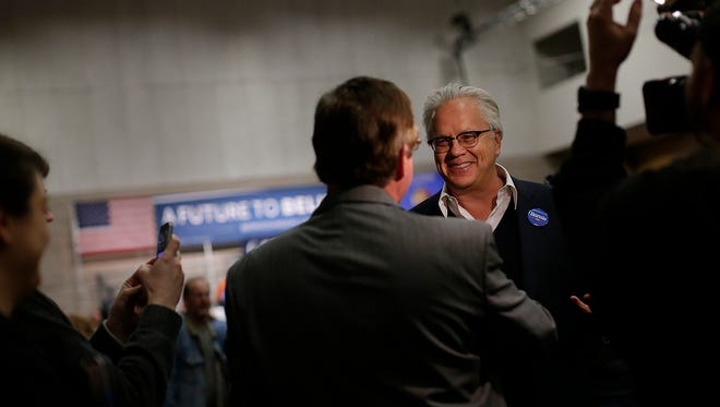 Actor and activist Tim Robbins is interviewed by the media at a Bernie Sanders campaign rally in downtown Green Bay, Wis.,  on April 4, 2016.
