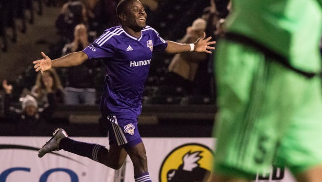 Louisville City FC's Kadeem Dacres celebrates after scoring a goal during the second half of play against Orlando City FC at Louisville Slugger Field, April 9, 2016, in Louisville, Ky.