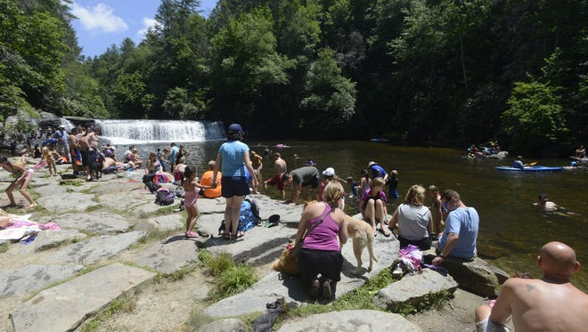 Visitors enjoy a summer day at Hooker Falls in DuPont State Recreational Forest. The Friends of DuPont have committed funds to build a restroom at the popular spot.