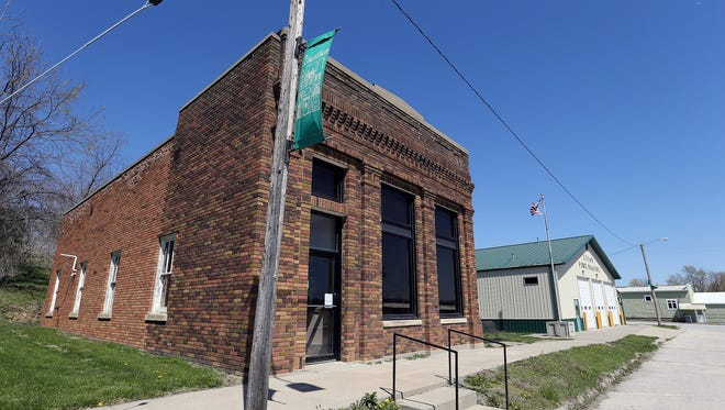 The Community Bank branch stands abandoned in Lucas Tuesday, April 12, 2016. The bank closed in December 2014, if opened as  Farmers & Miners Bank in 1883.
