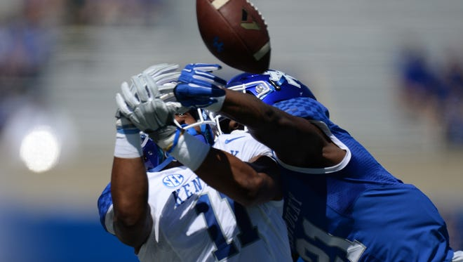 CB Chris Westry breaks up a pass intended for WR Tavin Richardson during the UK Blue-White Spring football game in Lexington, Ky., on Saturday, April 16, 2016. Photo by Mike Weaver