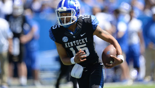 QB Stephen Johnson runs during the UK Blue-White Spring football game in Lexington, Ky., on Saturday, April 16, 2016. Photo by Mike Weaver