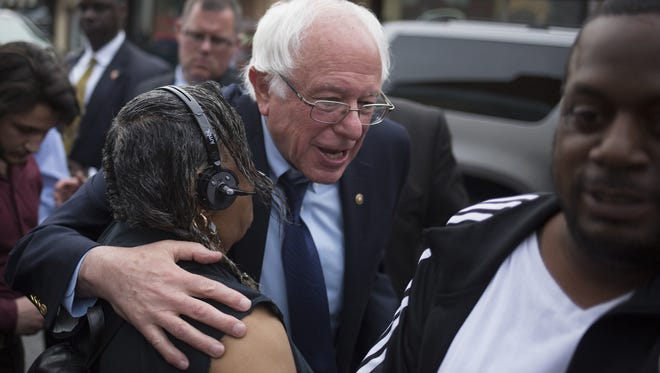 Bernie Sanders gives a woman a hug outside the restaurant. Democratic presidential candidate Bernie Sanders stopped at the White Rose Bar & Grill in York, Friday, April 22, 2016.