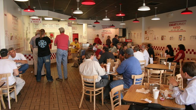 The lunch crowd waits for food orders at Five Guys Famous Burgers and Fries in Hockessin,  The eatery is closed for remodeling. It will reopen in early May.