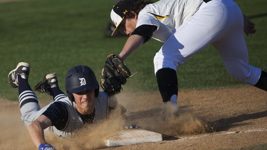 Dallastown's Joe Capobianco beats the tag of Red Lion's