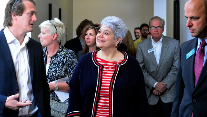 """Mark Zeleznock, CEO of Dataforma, left, gives State Department of Labor & Industry Secretary Kathy Manderino a tour of the ocal roofing industry software company, during the """"Jobs that Pay"""" tour, Monday, April 25, 2016. John A. Pavoncello photo"""