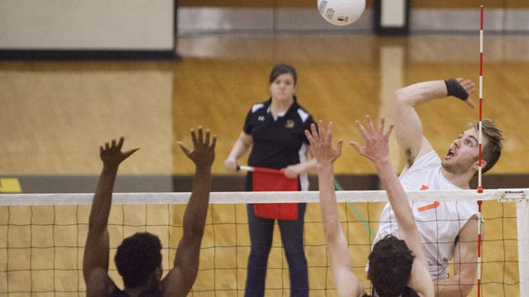 Northeastern's Reese Devilbiss, right, attempts to spike the ball. Northeastern defeats Red Lion 3-0 in volleyball at Red Lion High School, Tuesday, April 26, 2016.