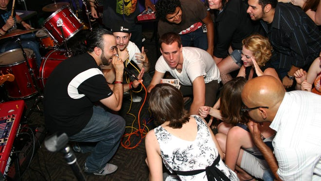 Fans oblige as Silent Knight of The Band Called Fuse invites them to get low during a song at the Old Bay in New Brunswick.
