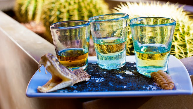 La Hacienda at the Fairmont Scottsdale Princess offers the Snake Bite Flight of three agave spirits -- tequila, mezcal and sotol -- served with a real (dead) rattlesnake head and tail.