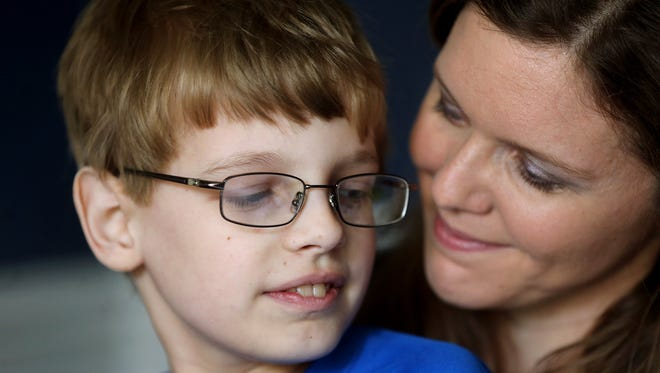 Honey Denson holds her 10-year-old son Luke Denson. She is able to donate stem cells that will help her son grow new bone marrow to replace his failing marrow.