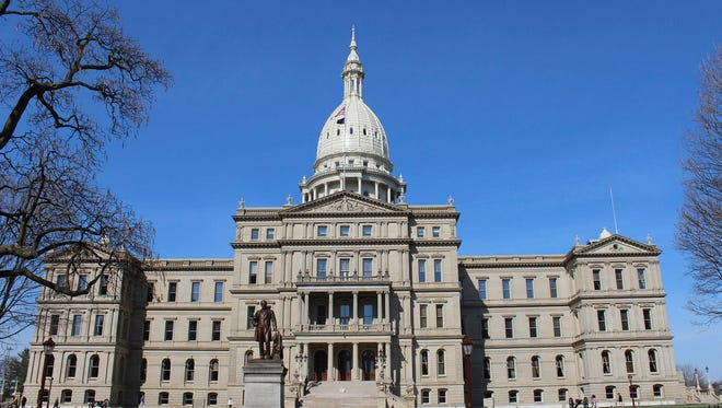 Michigan state Capitol building in Lansing, Mich. The Senate Judiciary Committee on Tuesday took up a bill — SB 896 — that would remove language that makes it illegal for a man and woman to live together without being married.