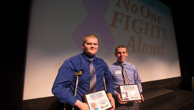 Owen-Withee's Will Maki, left, and Columbus Catholic's Ryan Dieringer are honored with story of the year during USA TODAY NETWORK - Wisconsin's High School Sports Awards at the Grand Theater in Wausau, Wednesday, May 11, 2016.