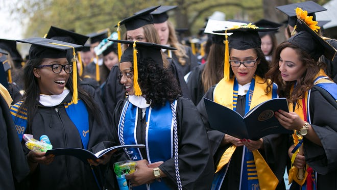 "Graduating seniors sing ""The Genesee,"" the University's Alma Mater, at the University of Rochester's Commencement ceremony in Rochester on May 15, 2016."