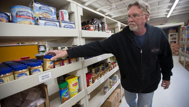 Worker Tom Corcoran of Wisconsin Rapids puts peanut butter on a shelf at the South Wood County Emergency Pantry Shelf in Wisconsin Rapids, Wednesday, May 4, 2016. South Wood County Emergency Pantry Shelf is located at 331 12th Avenue South in Wisconsin Rapids.
