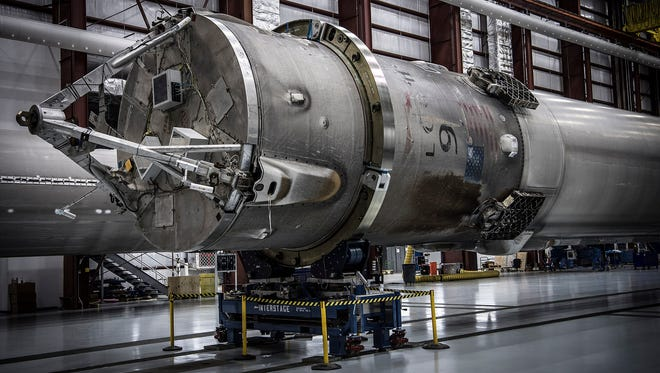 The SpaceX Falcon 9 rocket booster that launched the Japanese communications satellite from Cape Canaveral on May 6, 2016, after its return to the company's hangar at Kennedy Space Center's pad 39A on Saturday, May 14, 2016.