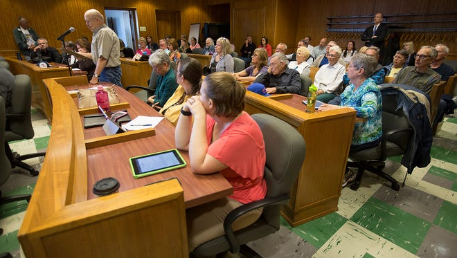 Members of the public speak out against the Wood County Board over their lack of action to protect the water of southern Wood County from a proposed large-scale dairy during the Wood County Board meeting, Tuesday, May 17, 2016.