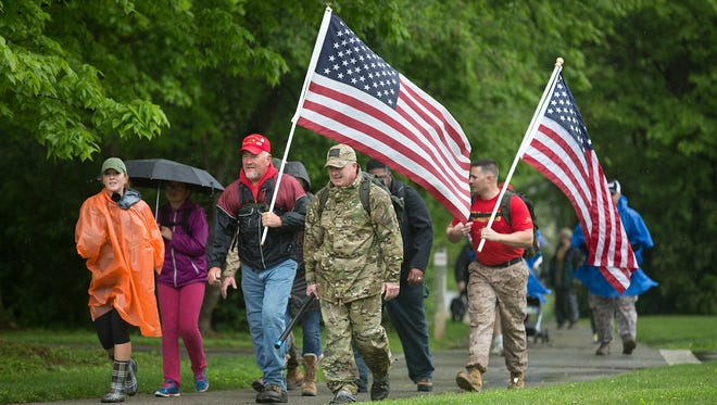 Bob Brunner of Spring Grove, left, and Roger Nestor of York, right, hike at John C. Rudy Park on Saturday. Active Heroes was holding a Carry the Fallen hike to bring awareness to veteran suicide and to help military families.
