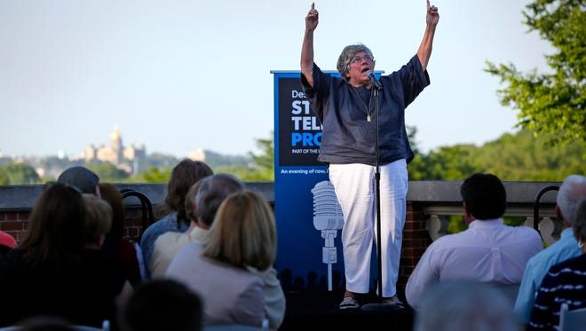 Judy Zobel tells a story about her childhood at the Des Moines Register Storytellers Project Thursday, June 2, 2016 at the Rollins Mansion.