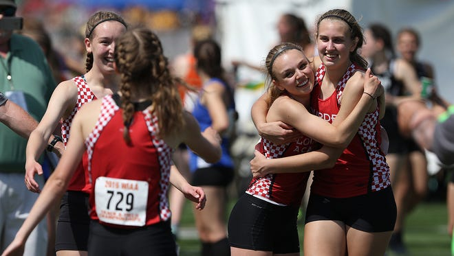 The Lourdes Academy 3200 meter relay team celebrates winning the event at the state track and field meet Friday, June 3, 2016, at the Veterans Memorial Stadium Complex in La Crosse, Wis.