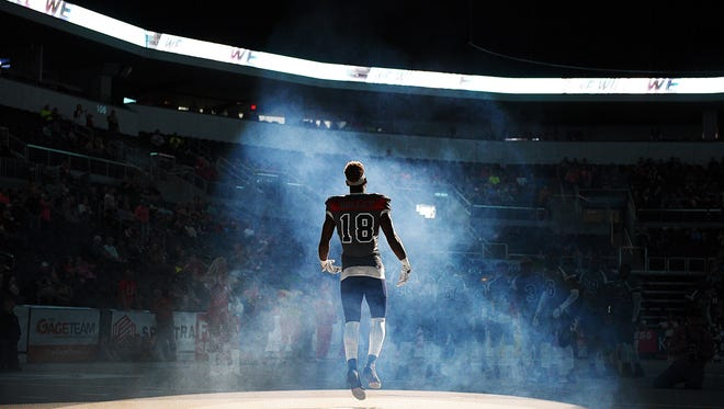 The Sioux Falls Storm's Caleb Holley (18) takes the field before a game against the Colorado Crush Saturday, June 4, 2016, at the Denny Sanford Premier Center in Sioux Falls.