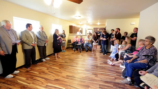 ADVOCAP Fresh Start Case Manager Stephanie Kaiser talks to guests and contributors to the ADVOCAP project house at 359 Arlington Ave. in Fond du Lac Thursday.