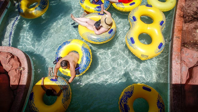 People relax on intertubes at Oasis Water Park on June 19, 2016