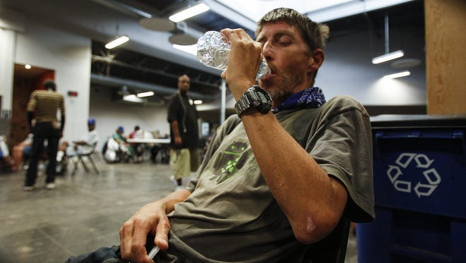 Wilson Cross from Phoenix drinks water at the Lodestar Day Resource Center on June 21, 2016