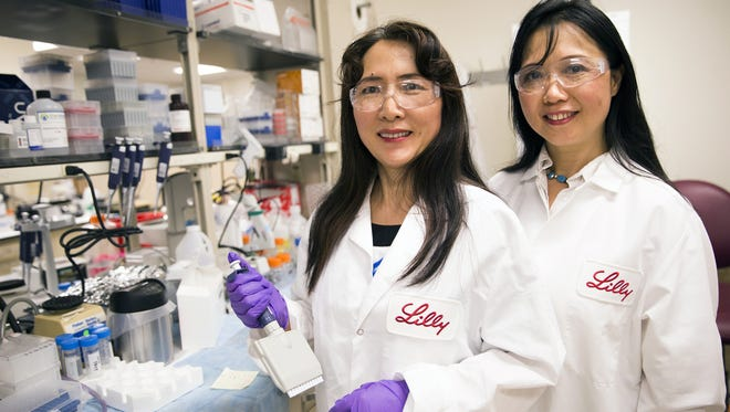 Ling Liu and Jirong Lu pose for a portrait inside a lab at Eli Lilly and Co. in Indianapolis on April 21, 2016.